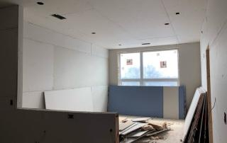 Muncie, Indiana Apartments - kitchen-living area drywall